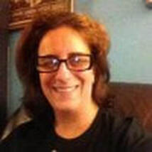 Rosemary Kiladitis headshot. She is wearing a black tshirt and glasses and smiling.